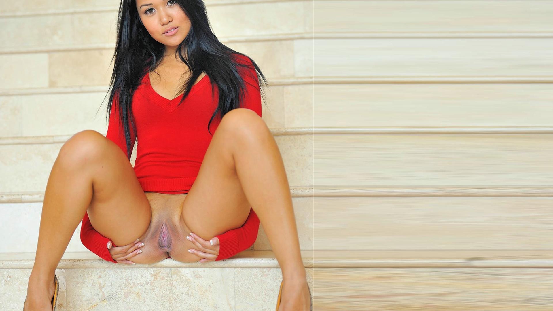 Beautiful girl in red stockings brings her pu 5